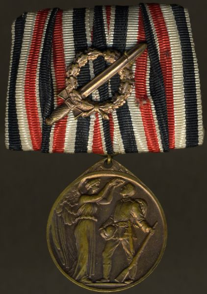 Einzelordensschnalle - Ehrendenkmünze des Weltkrieges mit Kampfabzeichen