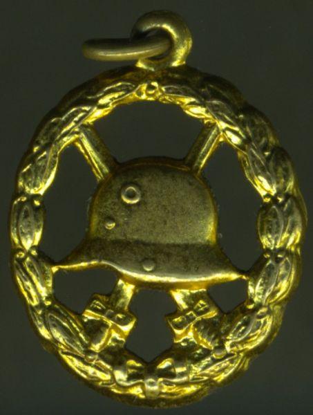 Miniatur - Verwundetenabzeichen 1918 in Mattgelb (durchbrochen)